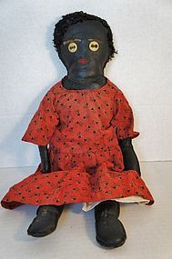Unusual oil cloth black doll 19th C. antique