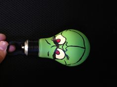 Hand painted grinch lift bulb by Zoe Johnson.