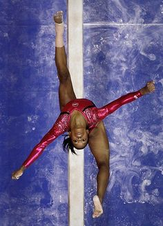San Jose, US: Gabby Douglas performs on the balance beam during the preliminary round of the women's Olympic gymnastics trialsPhotograph: Julie Jacobson/AP#Pin By:Pinterest++ for iPad#