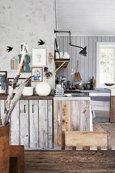 wooden cabinets, and love the idea of these lamps in the kitchen
