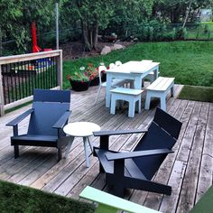 Loll Designs modern outdoor furniture on patio deck. Made in the USA from recycle plastic milk jugs!