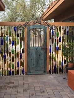blue bottles fence! I need a bottle cutter