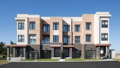 Create a unique appearance that mirrors the look of tumbled brick at a fraction of the cost with our Tumbled Series. Featured Image: Tumbled clay brick in Westmont and Finesse stones in Polar White, Mineral Gray, and Silhouette. Masonry Veneer, Architectural Features, Brickwork, Commercial Design, Brick Wall, Exterior Design, Facade, Multi Story Building, Mansions