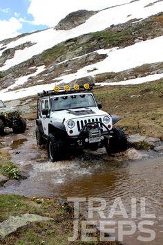 White Jeep Wrangler at Water crossings, Wheeler Lake Trail in Colorado