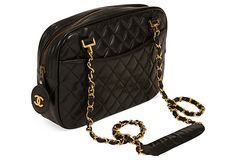 """Chanel Black Pocket Shoulder Bag offered by Archive Agency on OneKingsLane.com, (8/11/13). $2,800.00!  Black quilted lambskin bag with front & back pockets. Top zip closure with double brass chain strap hardware. CC toggle. Red leather interior lining. Comes with duster. Includes interior quilted attached wallet.  Size: 10''L x 2''W x 7''H; chain drop, 19""""L. This is a dream of mine to own."""