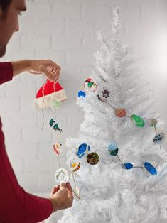 Drape the garland around your tree, turning the card circles so the most colorful side is visible.