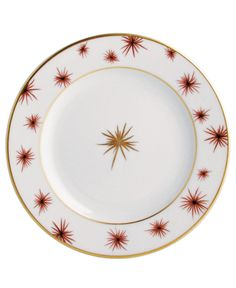 """Bold starbursts embellish the rim and center of this striking appetizer plate from Bernardaud. 