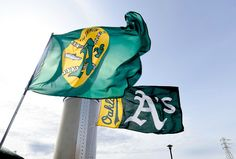 A's flags fly above the O.co Coliseum on Opening Day 2015