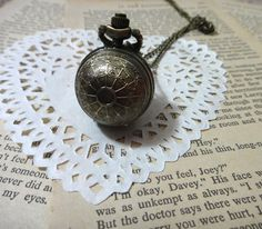 Black silver Irma Ball with spider web pattern pocket watch necklace pendant jewelry vintage style. $6.89, via Etsy.