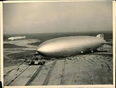 Hindenburg on the field at Lakehurst, decommissioned USS LOS ANGELES beyond.