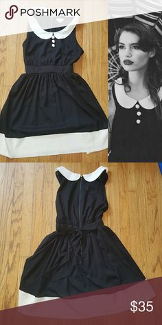 Peter Pan Collar Dress This dress is so sweet. Peter oan collar, buttons and tie back. Exposed zipper EUC  100% poly Waist: 15.5in Pit to pit: 19in Waist to hem: 19.5in Ruche Dresses Mini