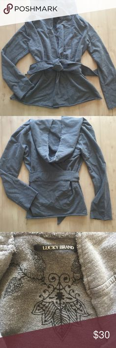 Lucky Brand Women's Hoodie Wrap Gray Sz XL Lucky Brand hoodie Wrap belted Gray XL . Pre owned excellent condition clean no holes no stains . Material is a sweatshirt reverse weave medium weight. Not flimsy not too heavy. Lucky Brand Tops Sweatshirts & Hoodies