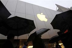 Customers enter the Apple flagship retail store to purchase the new iPad in San Francisco