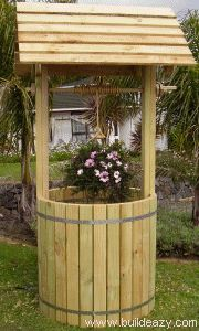 DIY Garden Wishing Well (with instructions) this would be a great idea for planting potatoes with a door on the bottom.