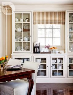 Use cabinets to frame the window.  Love this, but less glass.  Some drawers needed