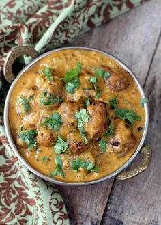 Raw Banana Kofta  Ingredients  For Koftas: Raw bananas - 2, boil in 3 cups water till soft Paneer - 3 tbsps (grated) optional Onion - 1, small, very finely chopped Besan - 1 tbsp Ginger - Green chili paste - 1 tsp Coriander powder - 1/2 tsp Amchur powder - pinch Coriander leaves - 2 tbsps, finely chopped Salt to taste Oil - for deep f