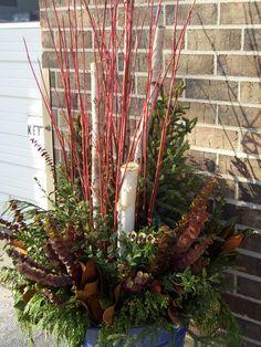 A winter planter outside our office in Richfield. #winterdecor #winterplanters