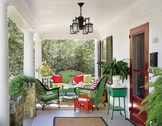 Colorful furnishings outfit the porch. (Photo: Francis Dzikowski)