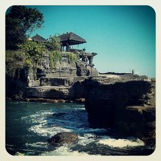 Tanah Lot, one of the most popular places of interest in Bali, is located on the coast of West Bali, at the village of Beraban in the Tabanan Regency. The temple Pura Tanah Lot, simple in its construction, is dramatic in its ocean-front location and is one of the main temples in the worship of Balinese gods. Tanah Lot has a long history in the world of tourism. The temple itself is built on a small promontory which is only accessible at low tide. During high water the rock takes on the…
