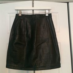 """Leather skirt Black 100% leather. 100% nylon lining. High-waisted, pencil/straight fit. Knee length. Zip fly and snap button. Vintage sizing: says size 8 on tag but fits as a size 2. 14"""" waist laying flat. 19"""" length. Not FP; just posted for the views. Free People Skirts"""