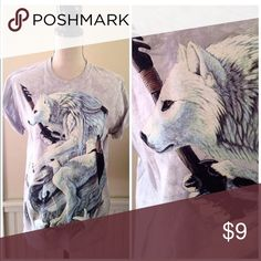 Amazing wolf graphic tee ... And then there was this. It's 100% cotton, crewneck tee shirt. Amazing wolf/man/hunter graphic on the front.  Size Medium Tops Tees - Short Sleeve