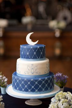 Feeling over the moon for this moon wedding cake by Truffle Toronto. Photography courtesy of Yianni Tong Photography.