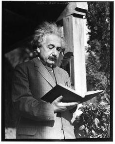 Albert Einstein reads.
