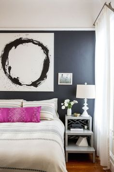 We're liking the vibe of this black bedroom wall.