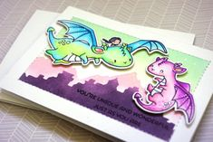 Good morning everyone! I'm here with a card using one of the newest released stamp sets from Mama Elephant. This is one my favourite stamps from this release because of all the colouring possibilities there are with the dragons! Using the Kingdom Trio creative cuts, I blended the background (LOVE the mountains!) and I stitched…