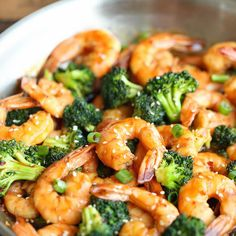 Easy Shrimp and Broccoli Stir Fry Recipe Main Dishes with olive oil, medium shrimp, broccoli florets, sesame seeds, green onions, reduced sodium soy sauce, oyster sauce, rice vinegar, brown sugar, ginger, garlic, sesame oil, corn starch, Sriracha