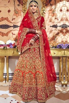 Red velvet semi stictch lehenga with velvet choli. This lehenga choli is embellished with resham, zari, stone, aari, hand, zardosi and embroidered.Product are available in 32 to 58 sizes. It is perfect for Bridal Wear,Wedding Wear,Bridesmaid Wear,Guest of Wedding Wear. #lehengacholi #usa #Indianwear #Indiandresses #andaazfashion Indian Wedding Lehenga, Indian Lehenga, Floral Lehenga, Bridal Lehenga Choli, Indian Skirt, Indian Dresses, Salwar Kameez, Bridal Outfits, Bridal Gowns