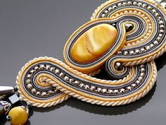 Gray yellow ecru Soutache necklace with mother of pearl and
