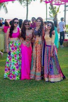 Multi colored mehendi lehenga styled with polki studded bridal necklace set for a fun filled outdoor mehendi ceremony held at Grand Hyatt, Goa. | weddingz.in | India's Largest Wedding company | Indian Sangeet Celebrations | Indian Bridesmaids Fashion Inspiration | Indian Weddings |