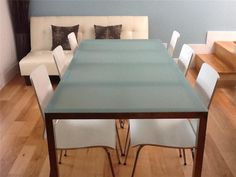 Such a great table to keep the room crisp and simple, or dress up with placemats and a centerpiece! Frosted glass Dining Table with 6 white wood/chrome leg chairs - Austin