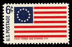 """This stamp, called the """"First Stars and Stripes"""" issue, shows the iteration of the American flag that was first developed after Congress's Flag Act was passed on June 14, 1777."""