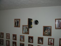 home projector shelf hidden in wall behind a family picture hinged to the wall. GREAT IDEA