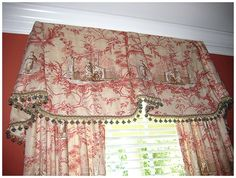 Another well done toile valence with draperies. See how the ball fringe pulls out the accent color in the fabric? Perfect!