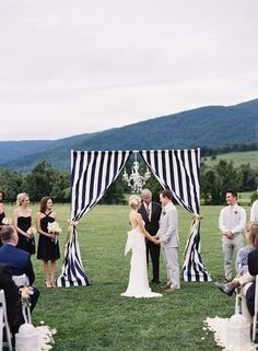 WEDDING ARBOR WITH NAVY STRIPES http://www.itgirlweddings.com/blog/9-reasons-to-have-a-nautical-wedding