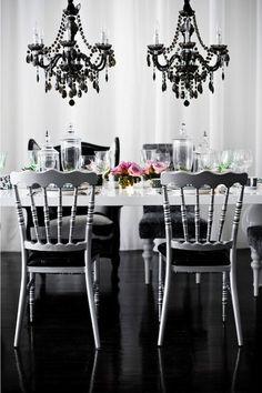 LOVE those black chandeliers!