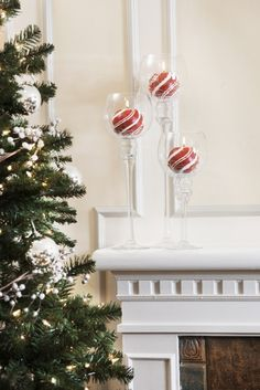 pretty candy cane-striped votives in glass containers/ or wooden balls or even paper mâché ones painted with indentation for a battery tea light.