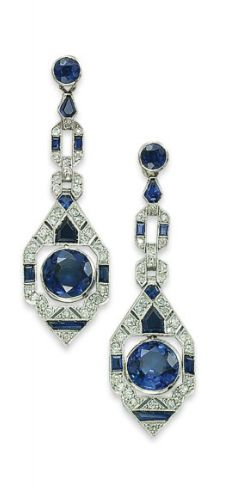 A PAIR OF ART DECO SAPPHIRE AND DIAMOND EAR PENDANTS  Each suspending a circular-cut sapphire collet in a sapphire and diamond geometrical openwork surround, to the similar links and circular-cut sapphire collet tops, circa 1925, 5.2 cm.