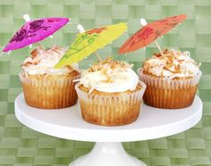 Pina Colada Cupcakes. Bliss for when you can't get to a beach... or get caught in the rain!