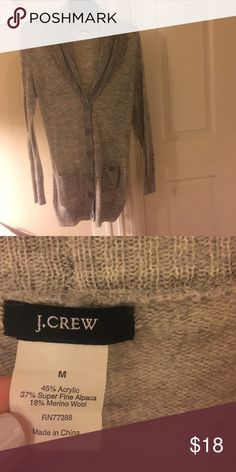 J. Crew Sweater Light gray J. Crew longer sweater. Buttons down the front and two pockets. Very soft and in excellent condition. J. Crew Sweaters
