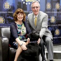 The extra sense that alertsa dogto danger or distress is inexplicable, but very real. Calgary, Alberta,resident Michelle Dawsonknows thatfirsthandafter her black Labrador (pictured above with Dawson and her husband, Gordon) frantically begged to go outside one day, then pestered her to follow him across the street to the banks of the Bow River.