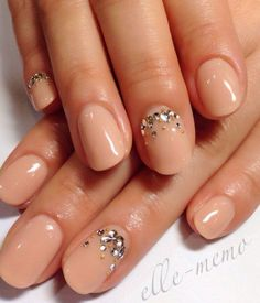 Glorious looking nude nail art with silver embellishments on top. Add embellishments to the cuticle part of the nails to give more effect to the nail art.