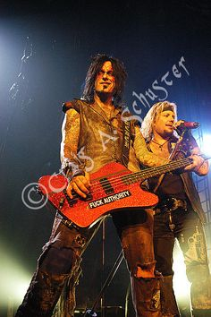 Fan Photo of Nikki Sixx and Vince Neil of Motley Crue ©Craig A. Schuster. Carnival of Sins Tour 2005 from Calgary Canada.