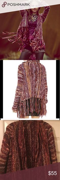 Free People Fringe Sweater Free People Fringe Sweater in Excellent Condition. The colors are amazing . So many compliments the few times I wore this . Free People Sweaters Shrugs & Ponchos