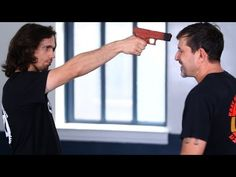 How to Defend against a Gun to the Face | Krav Maga Defense. Self defense applications and martial arts