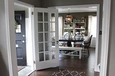 wood floors, white trim, grey walls