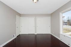 Wood floors, gray walls, white trim and a HUGE window. Love.